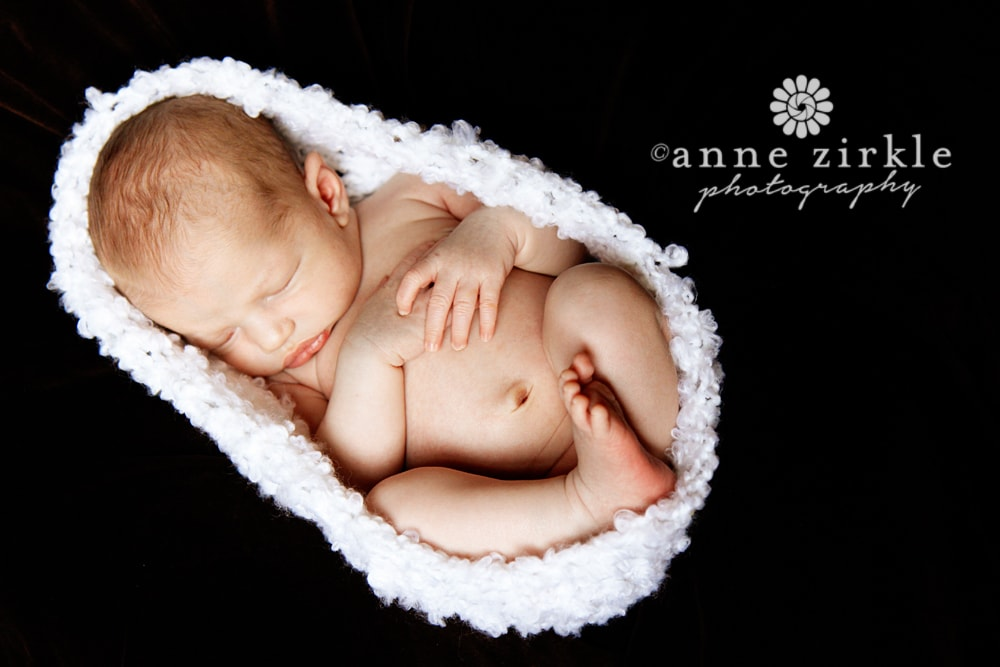 newborn-boy-sleeping-in-cocoon