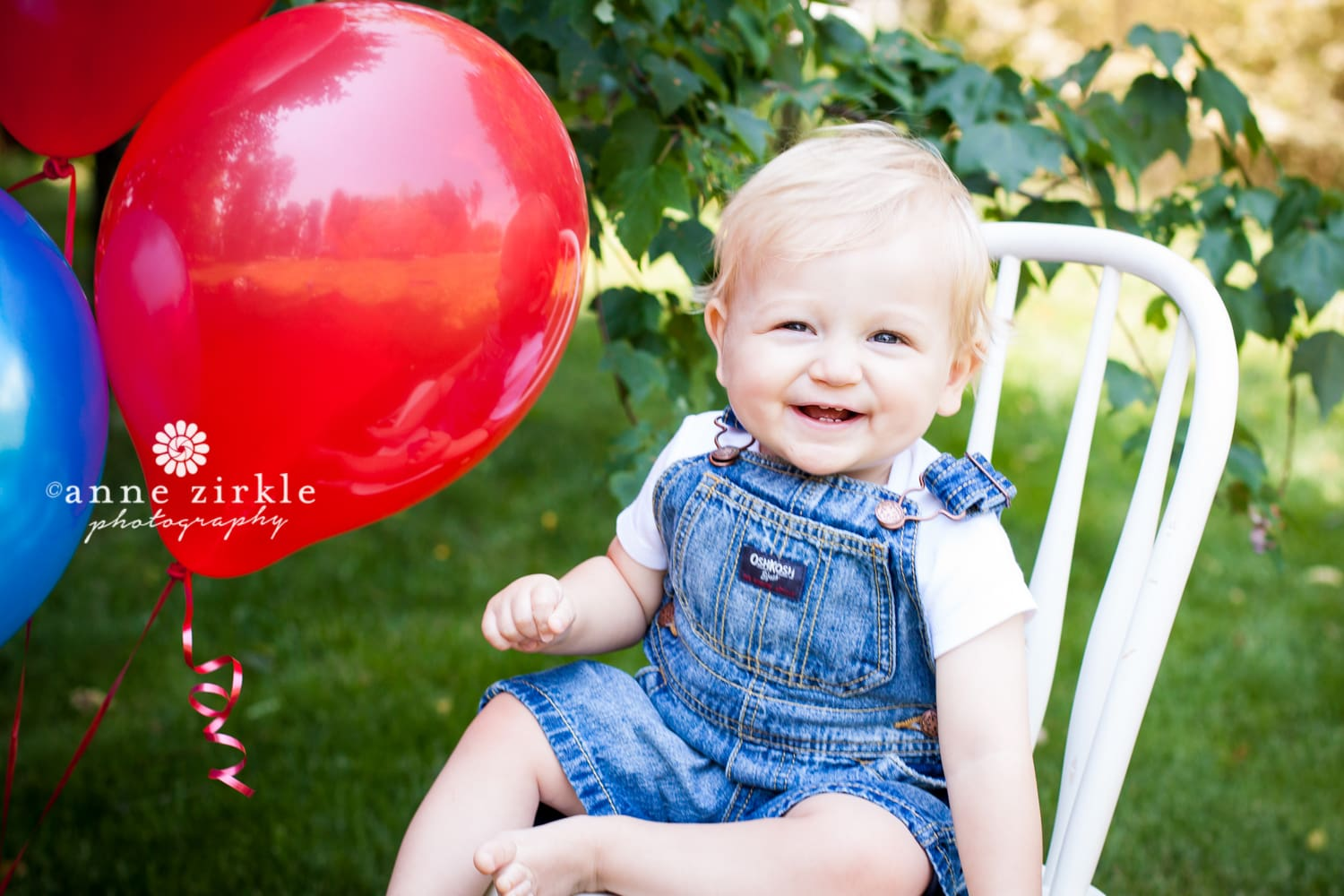 baby-boy-with-balloons-outside