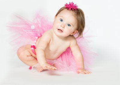 baby-girl-crawling-in-pink-tutu