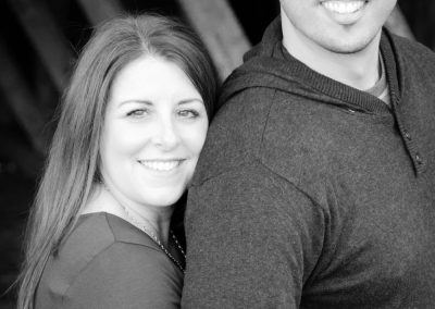 couple-hugging-at-barn