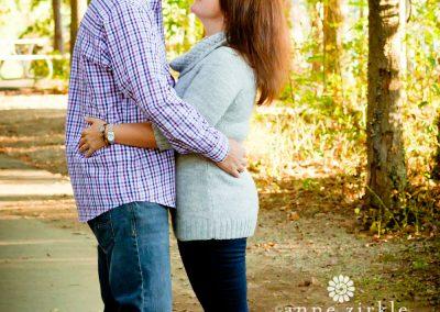 couple-hugging-in-autumn-woods