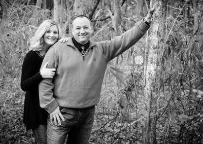 couple-hugging-in-woods