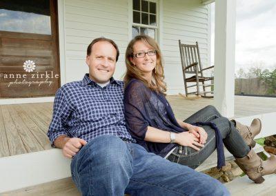 couple-sitting-on-farmhouse-porch