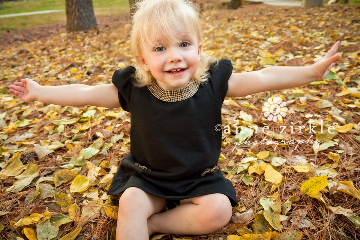 little-girl-playing-in-leaves1