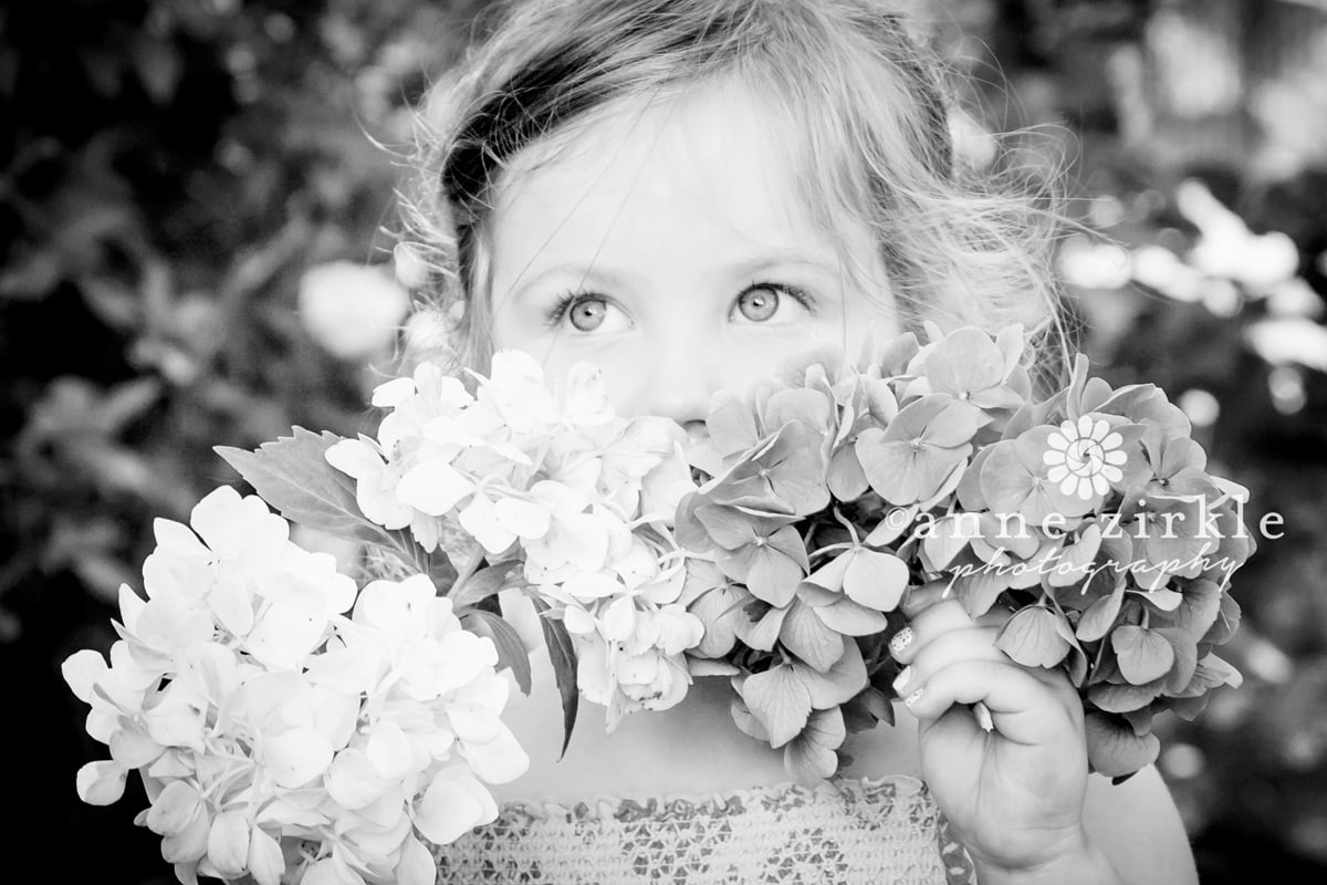 little-girl-smelling-hydrangeas1