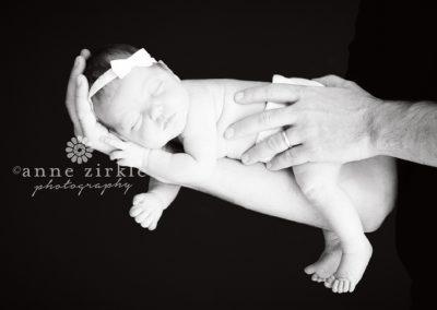 newborn-baby-sleeping-on-fathers-arm