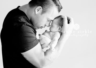 newborn-girl-held-by-father