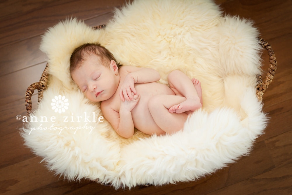 newborn-girl-sleeping-in-a-basket