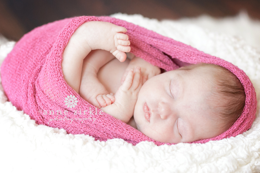 newborn-girl-wrapped-in-pink