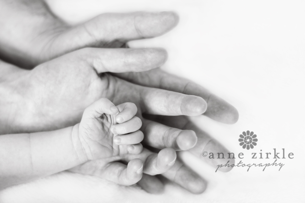 newborn-hand-in-mothers-hand-in-fathers-hand