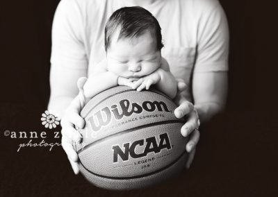 newborn-on-basketball-with-dad