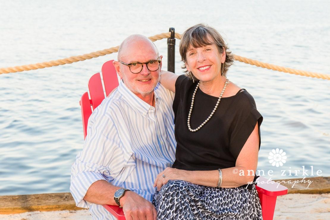 older-couple-sharing-adirondack-chair