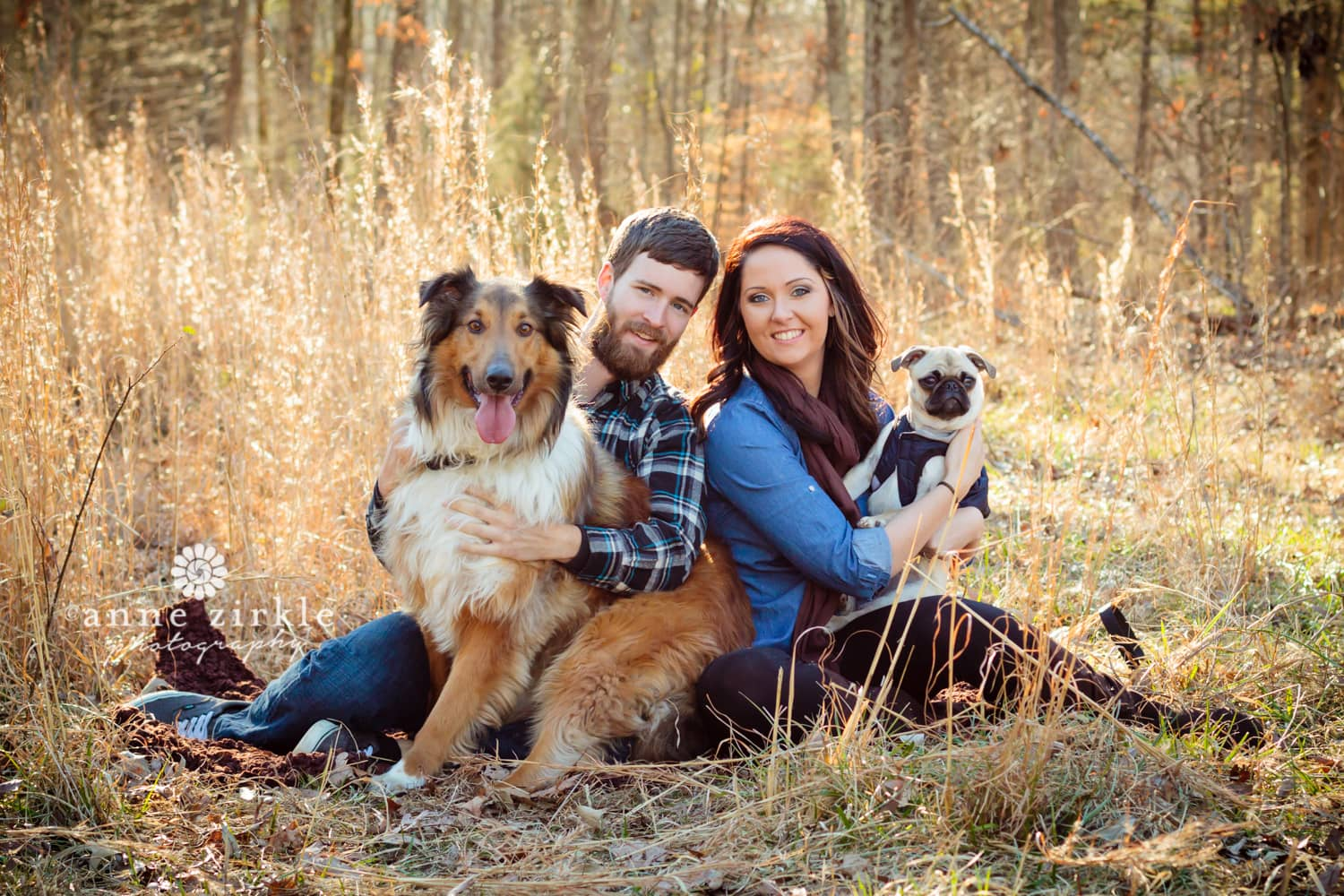 young-couple-with-dogs-in-autumn