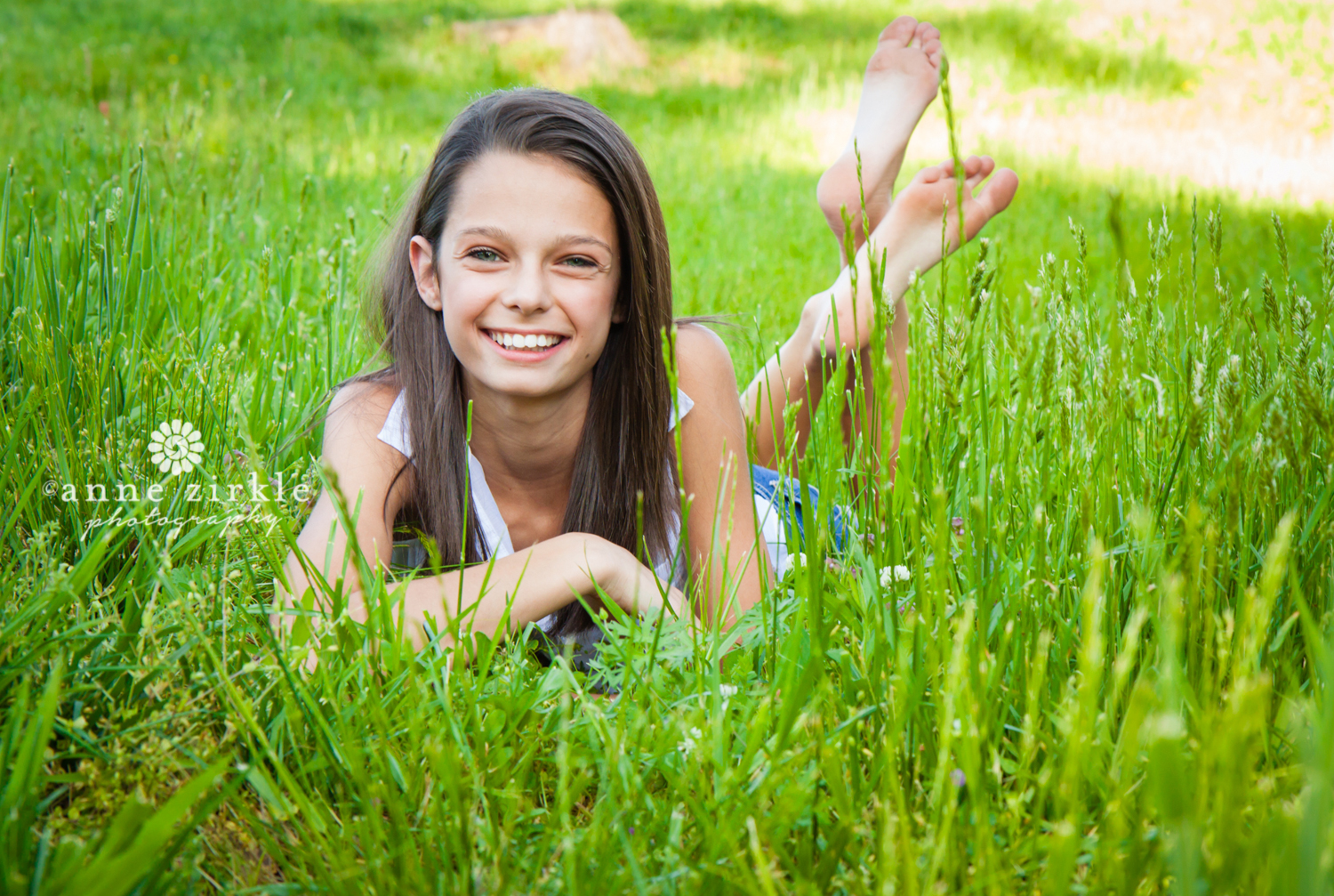 young-teen-girl-lying-in-grass