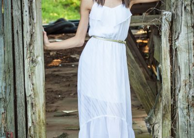 young-teen-girl-standing-in-old-barn