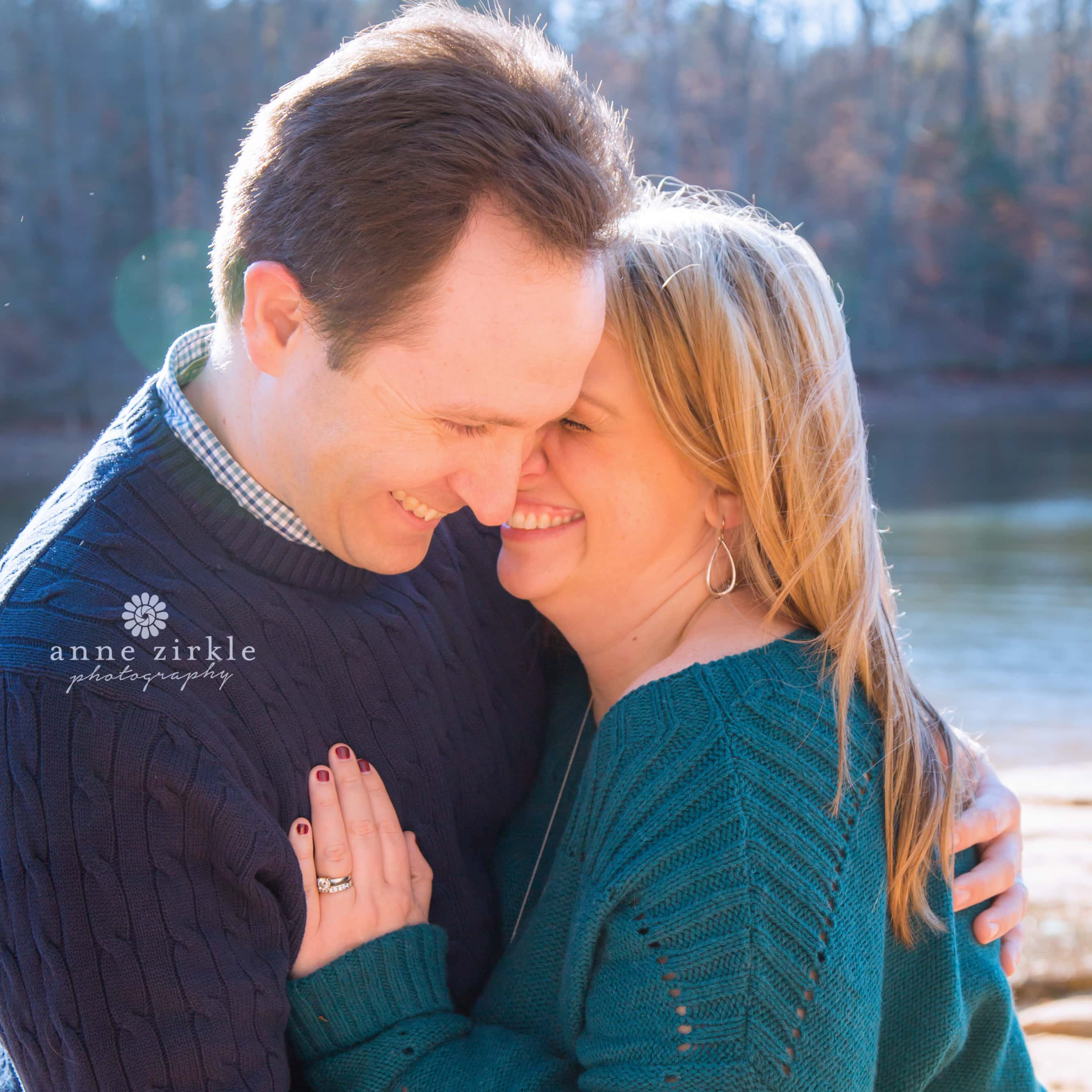 Couple Laughing and Hugging by Lake Norman