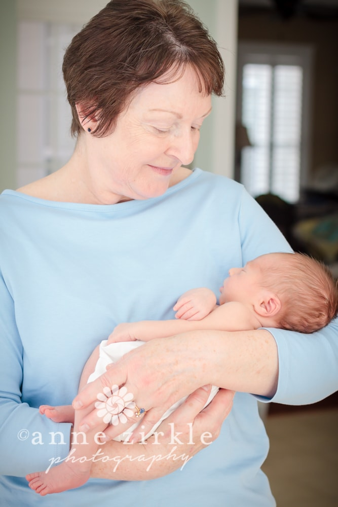 newborn held by grandmother Mooresville and Lake Norman newborn baby photographer
