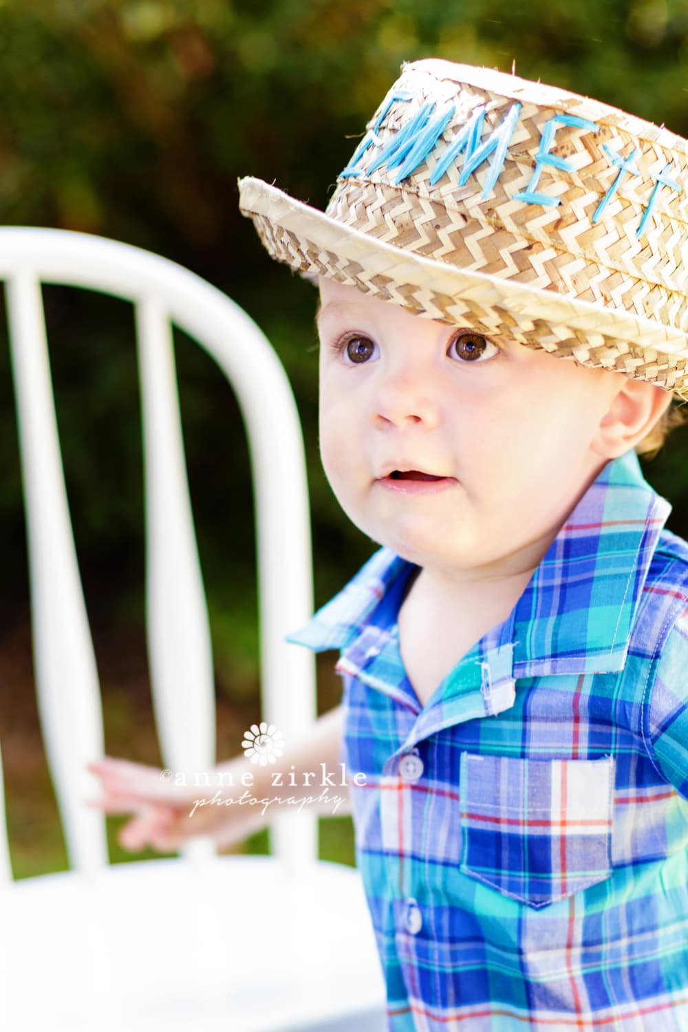 baby-boy-wearing-straw-hat