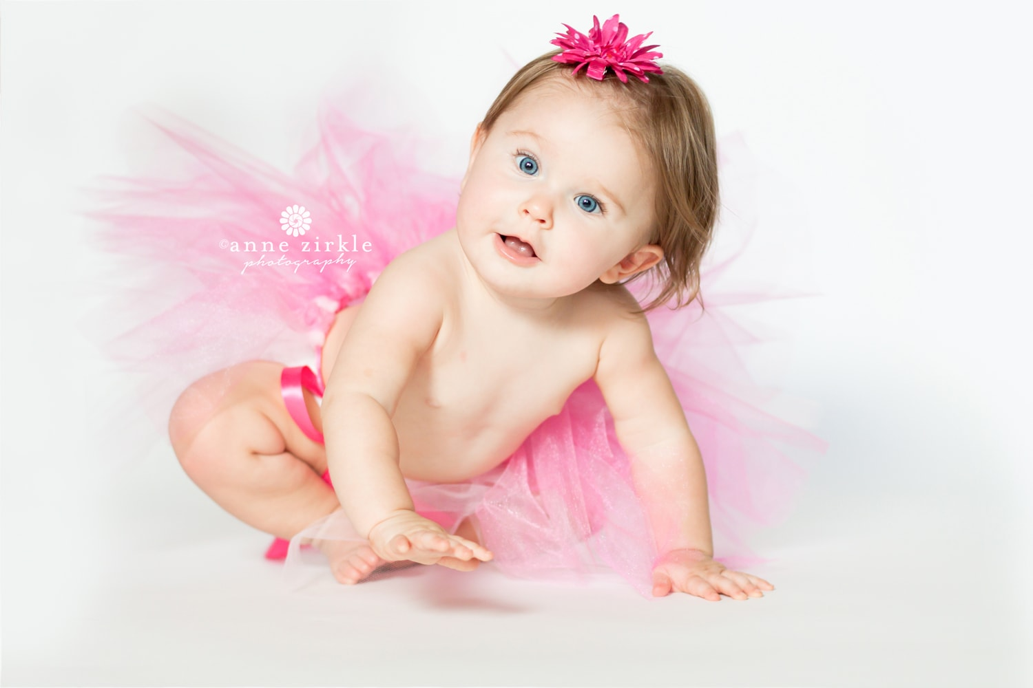 baby-girl-crawling-in-pink-tutu