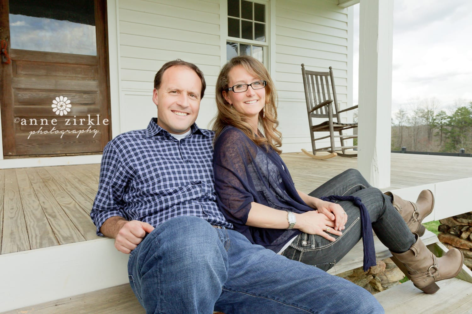 couple-sitting-on-farmhouse-porch