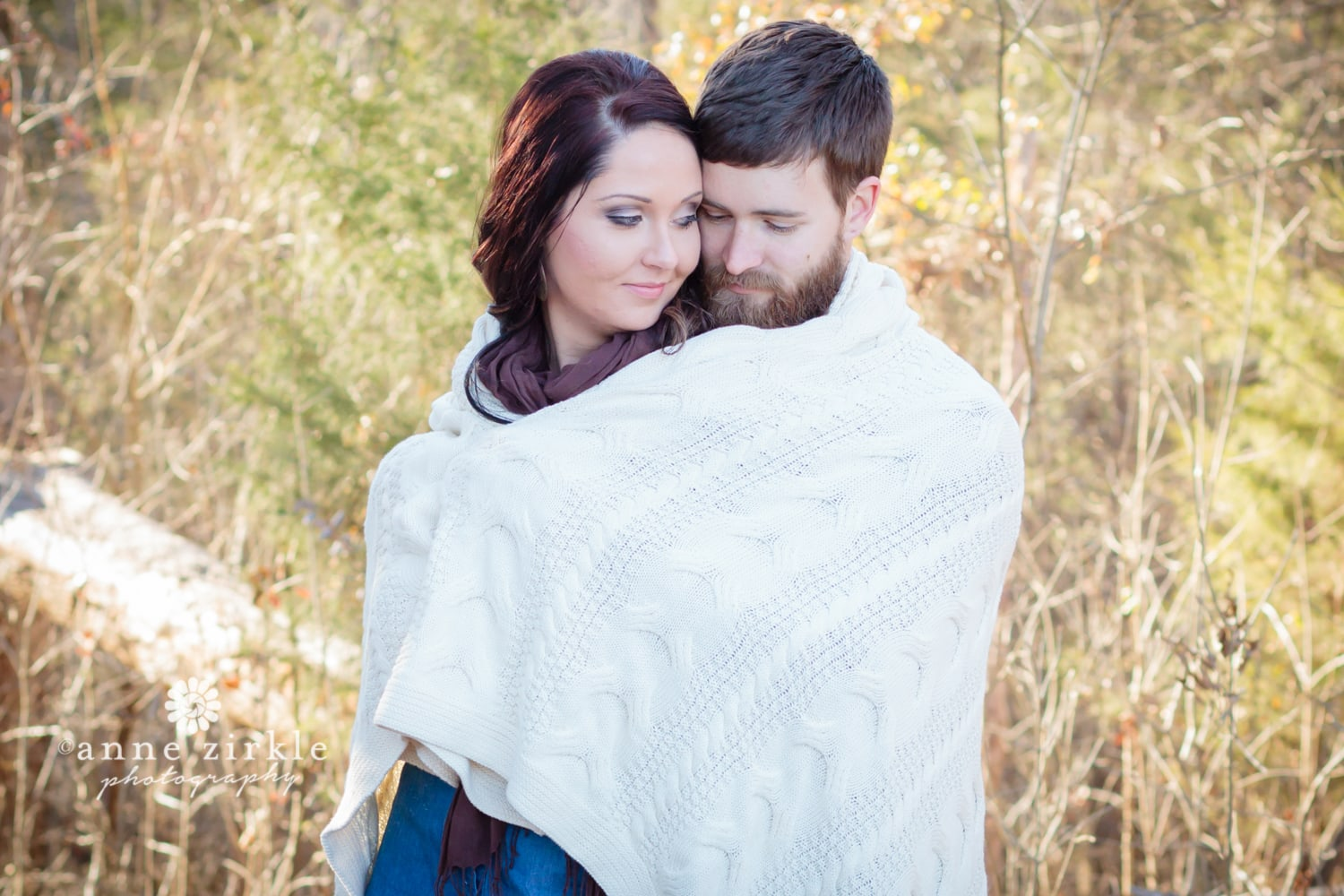 young-couple-snuggled-in-blanket