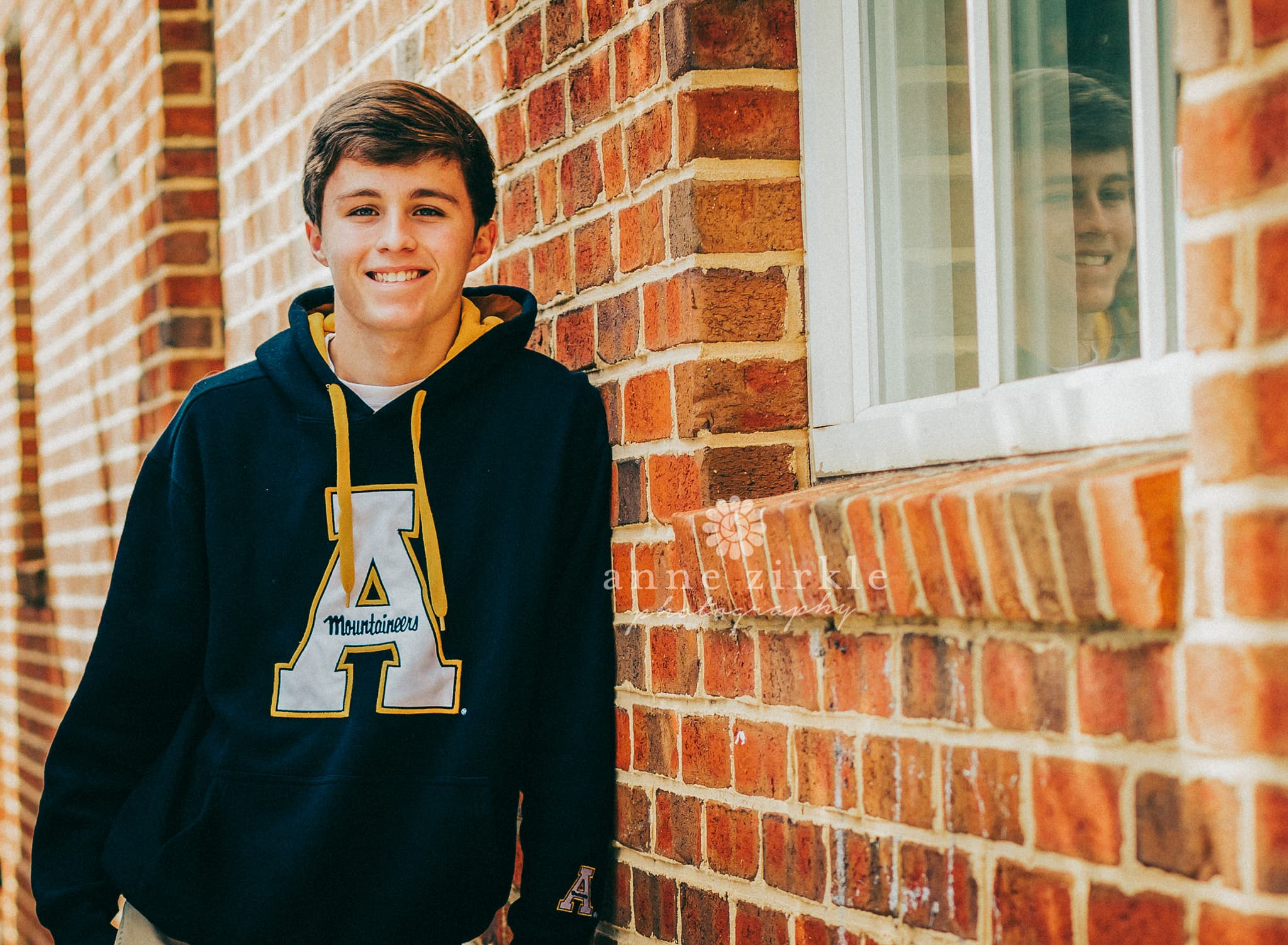 senior boy standing by brick wall #mooresville #northcarolina #davidson #lakenorman #southiredell #pinelakeprep #highschool #highschoolsenior #highschoolseniors #seniors