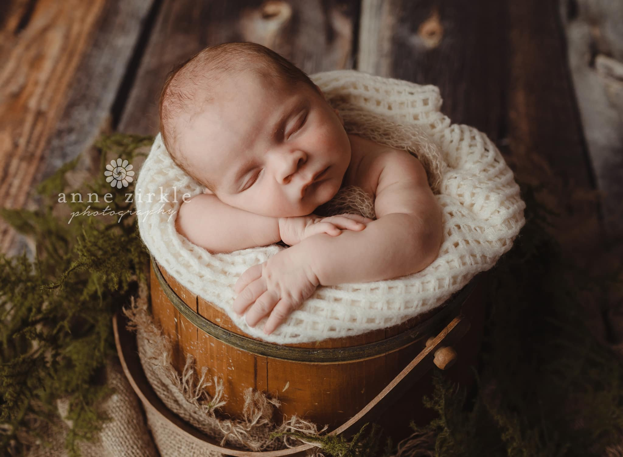 newborn baby in antique bucket Mooresville and Lake Norman newborn baby photographer
