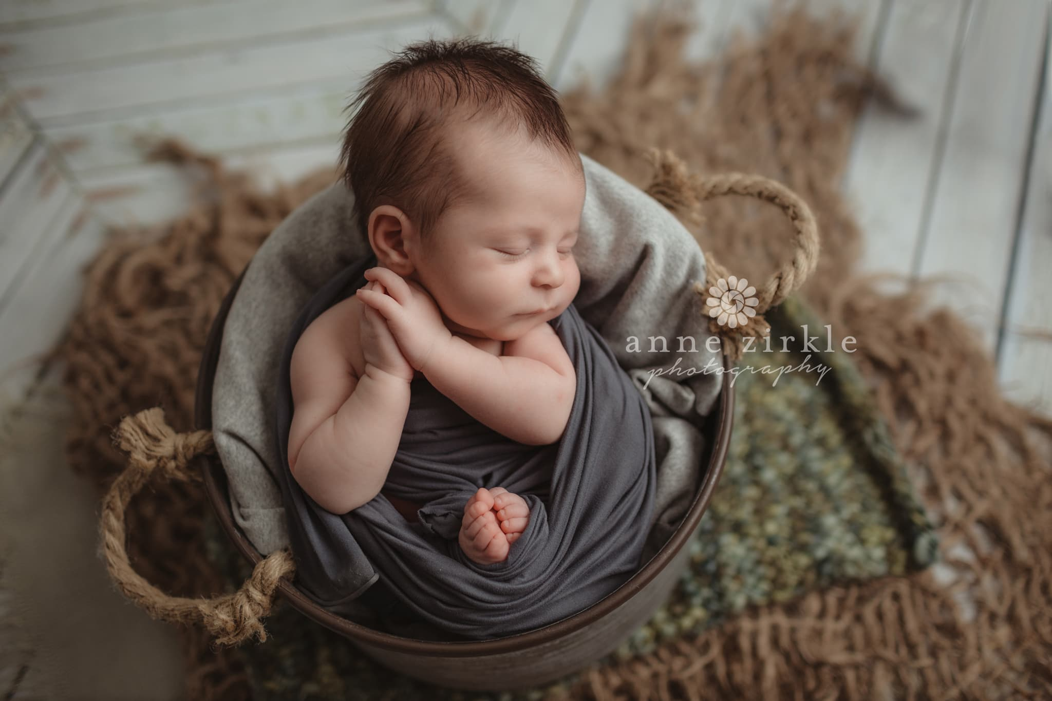 newborn boy in bucket with textured layers Mooresville and Lake Norman newborn baby photographer