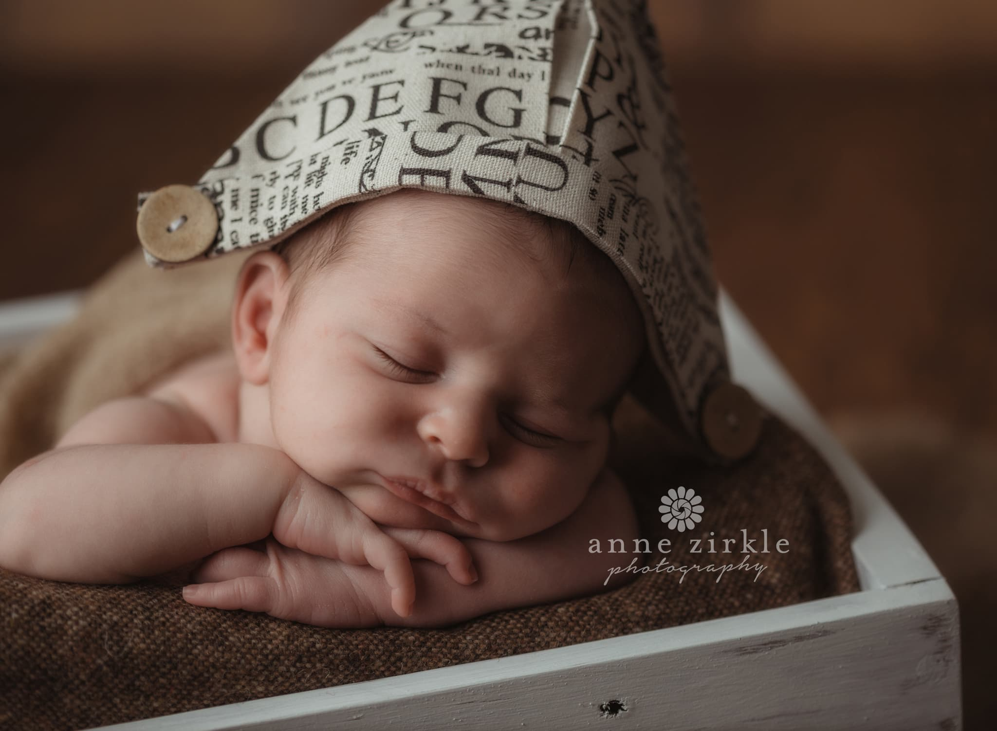 newborn boy in newspaper hat Mooresville and Lake Norman newborn baby photographer