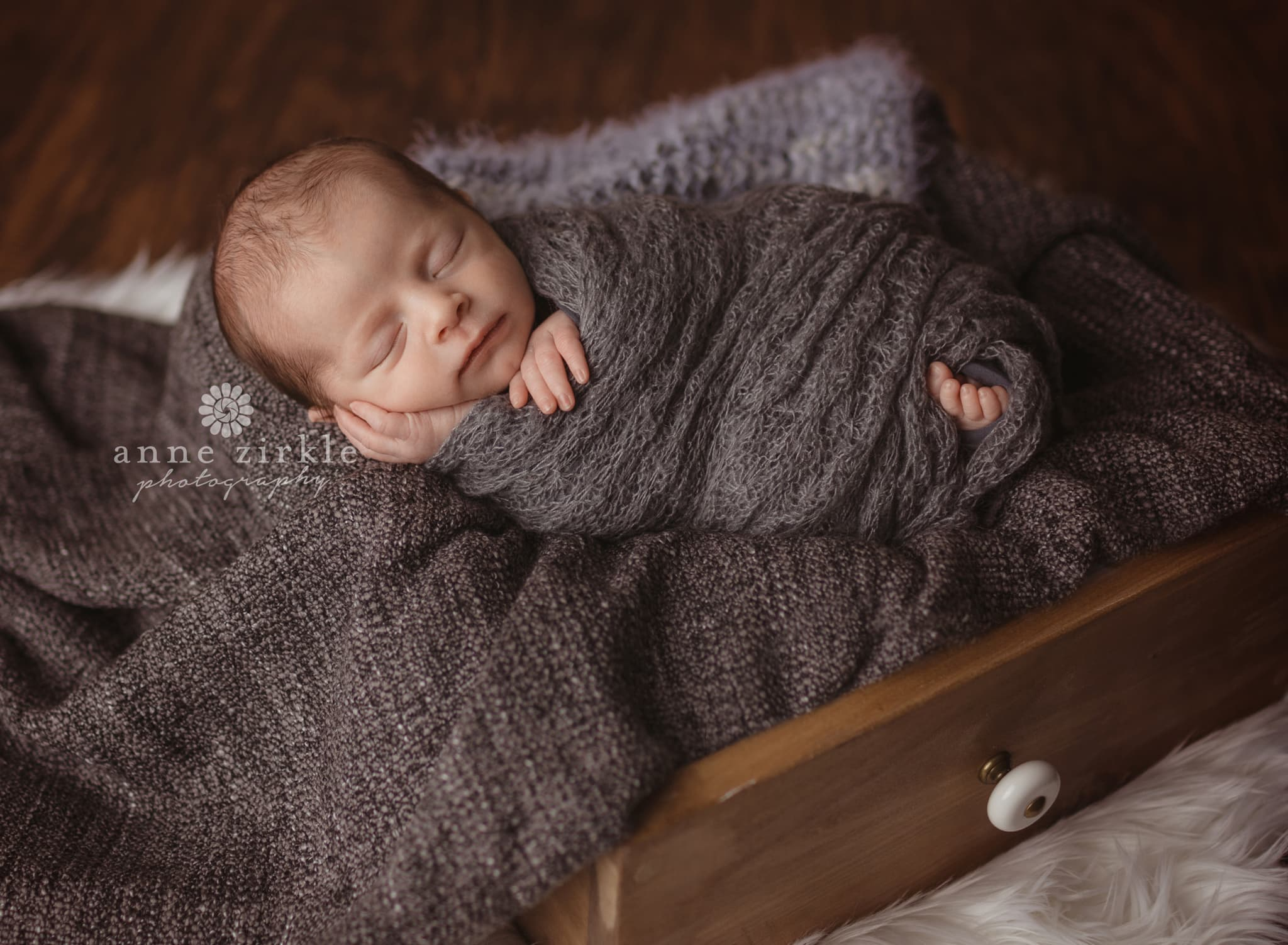 newborn boy swaddled inside a wood drawer Mooresville and Lake Norman newborn baby photographer