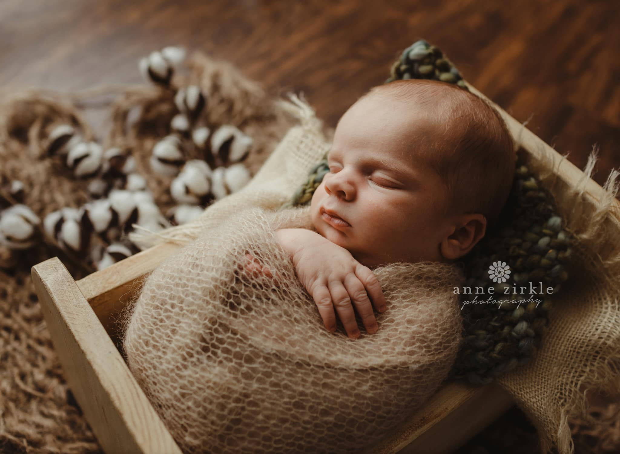 newborn boy swaddled in miniature bed Mooresville and Lake Norman newborn baby photographer
