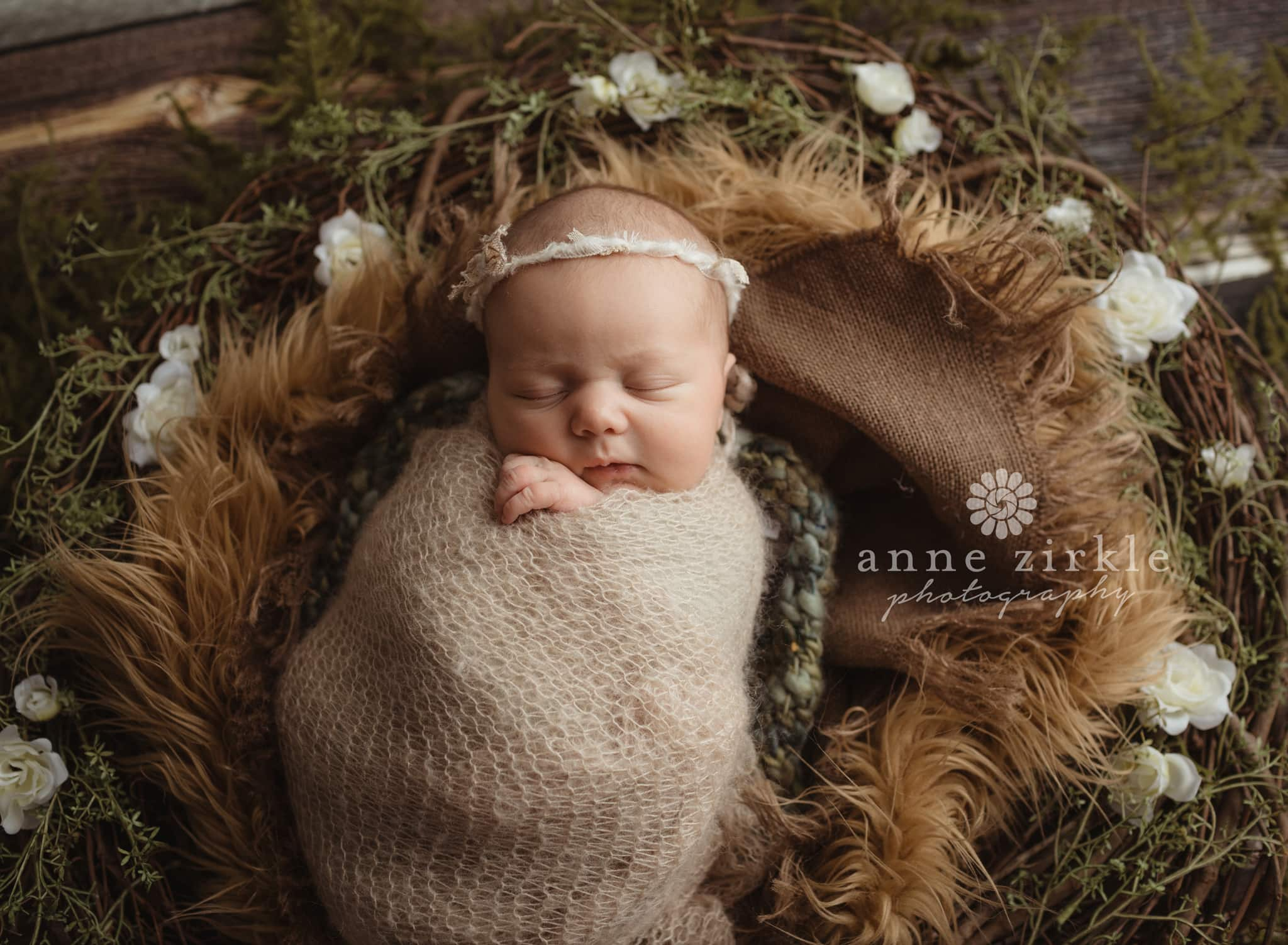 newborn girl in floral wreath Mooresville and Lake Norman newborn baby photographer