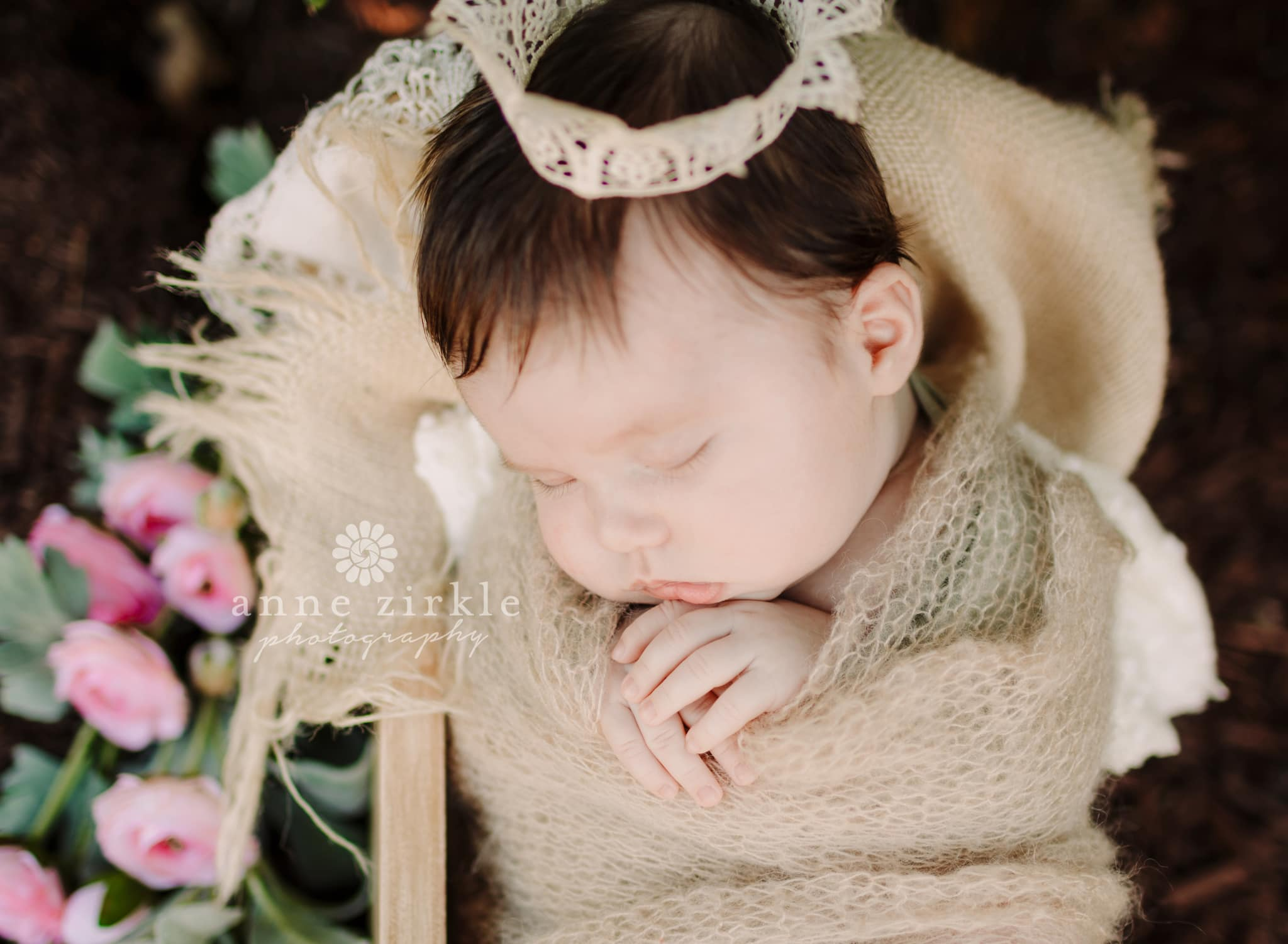 newborn girl outside with flowers and crown Mooresville and Lake Norman newborn baby photographer