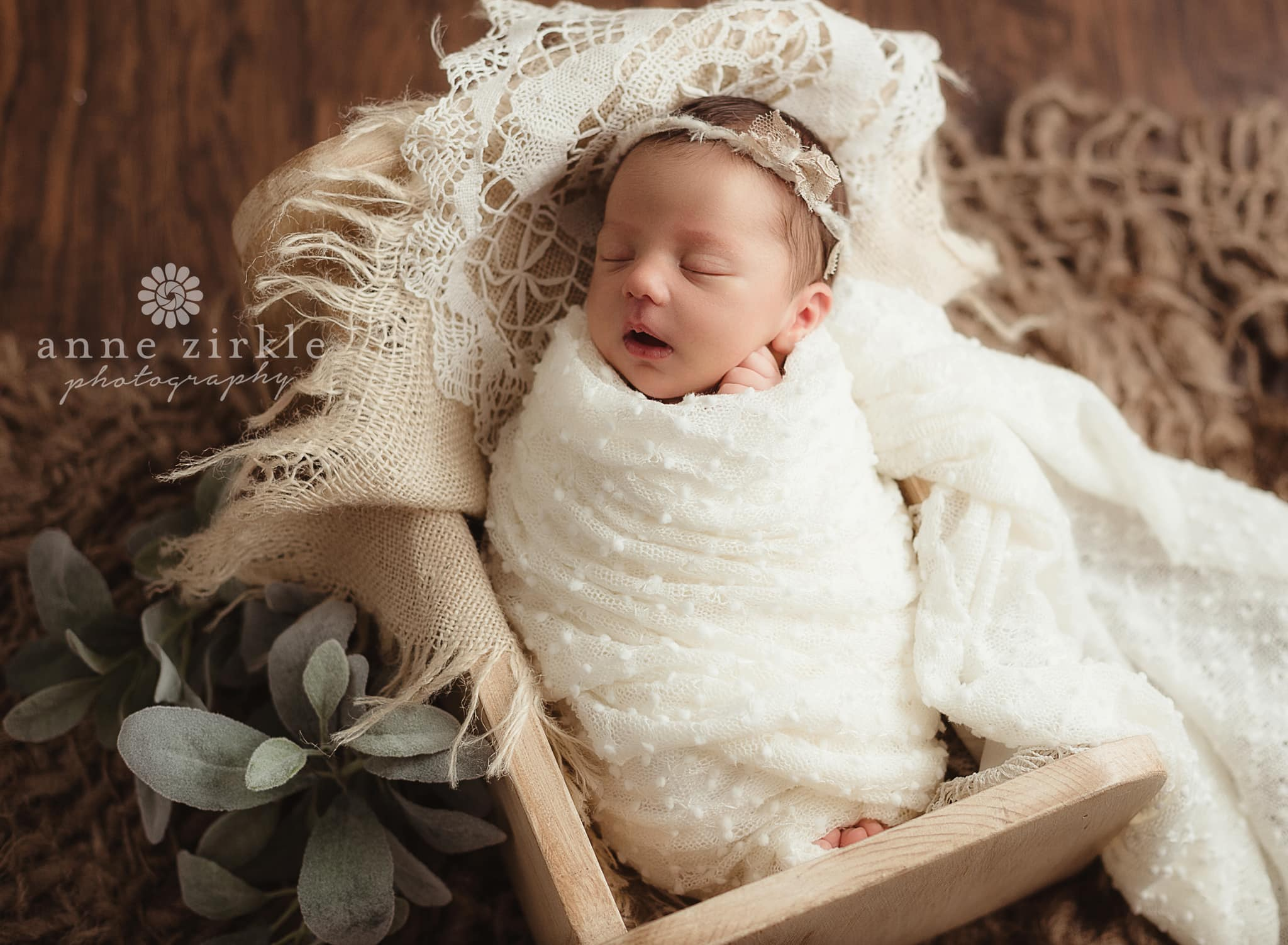 newborn girl swaddled in mini bed with antique lace Mooresville and Lake Norman newborn baby photographer
