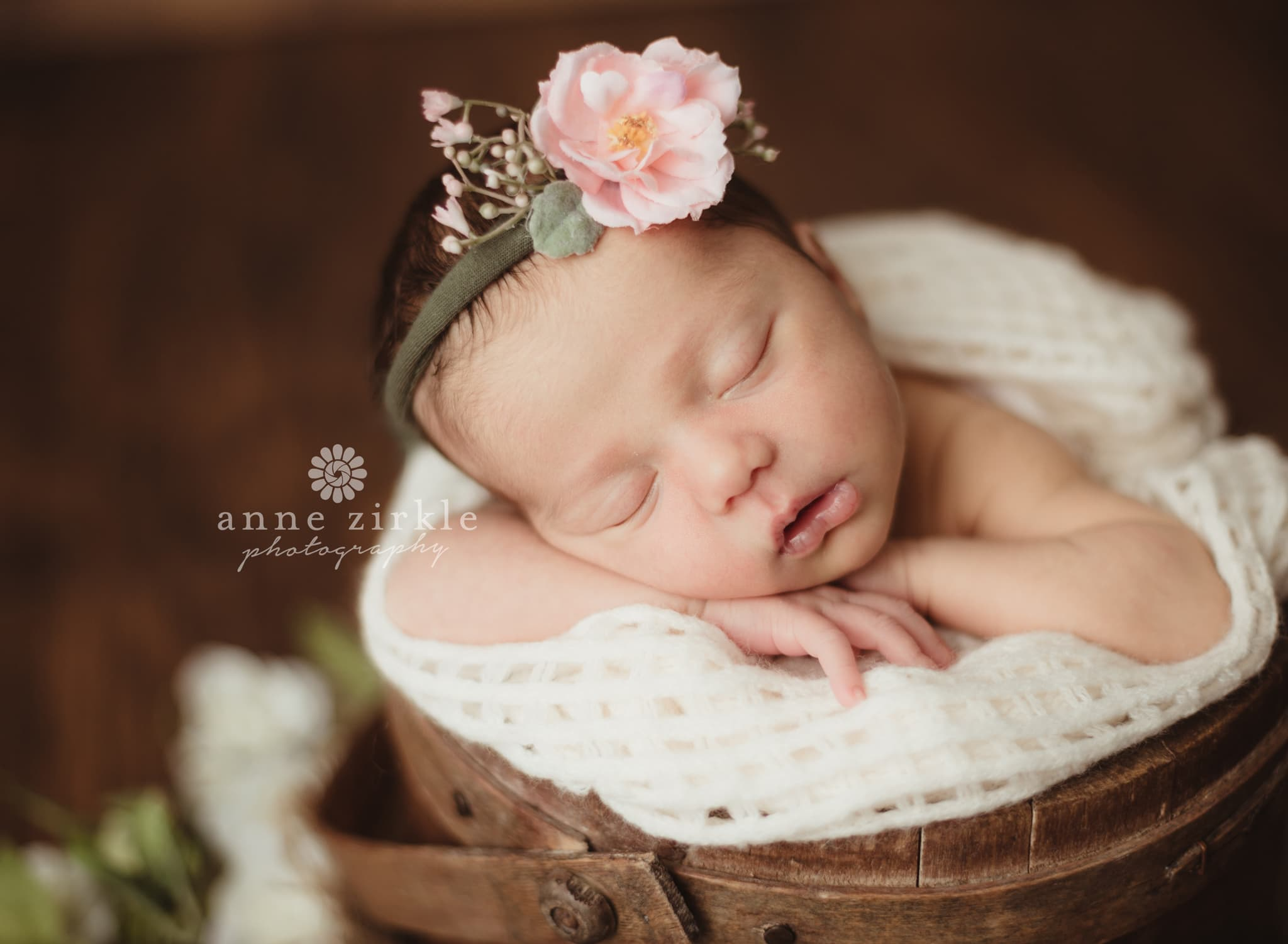 newborn girl with pink floral headband in bucket Mooresville and Lake Norman newborn baby photographer