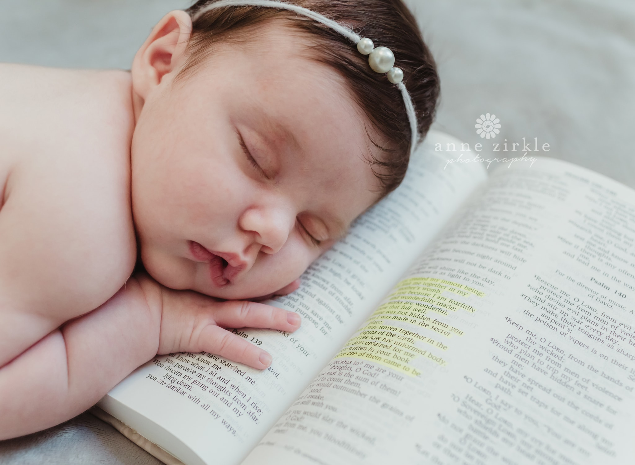 newborn girl with pearl headband and Bible Mooresville and Lake Norman newborn baby photographer