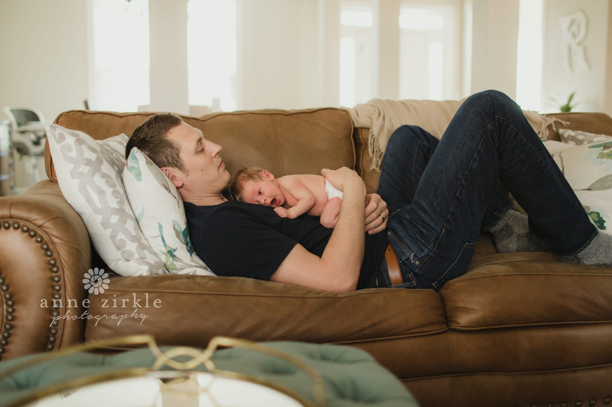newborn lying on dads stomach lifestyle Mooresville and Lake Norman newborn baby photographer