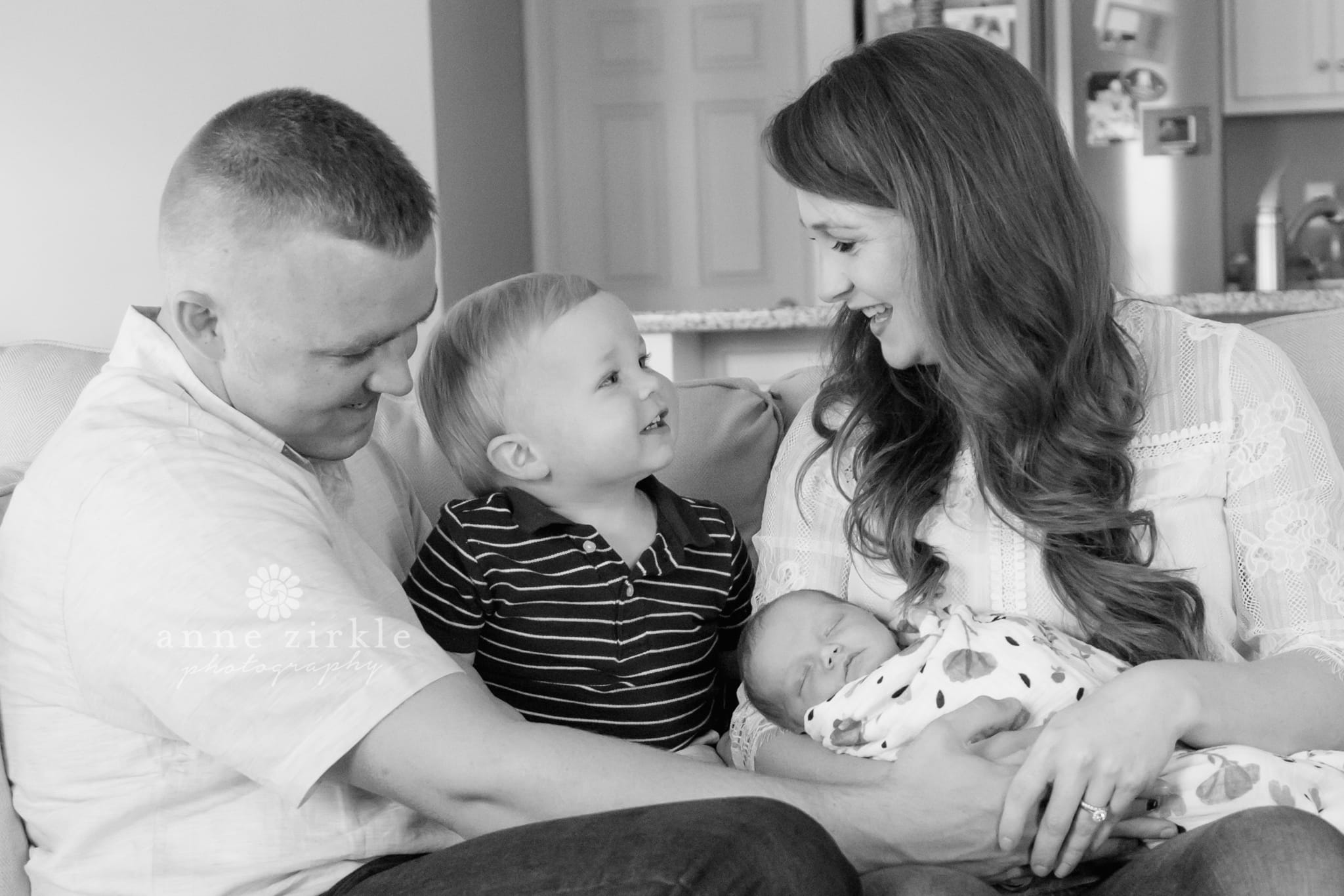 newborn with parents and big brother lifestyle Mooresville and Lake Norman newborn baby photographer