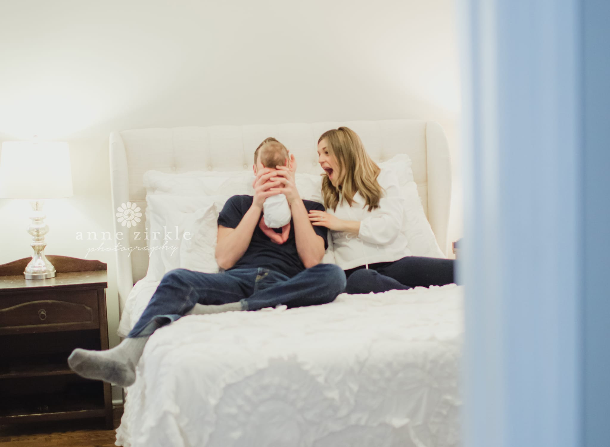newborn with parents in bed lifestyle Mooresville and Lake Norman newborn baby photographer