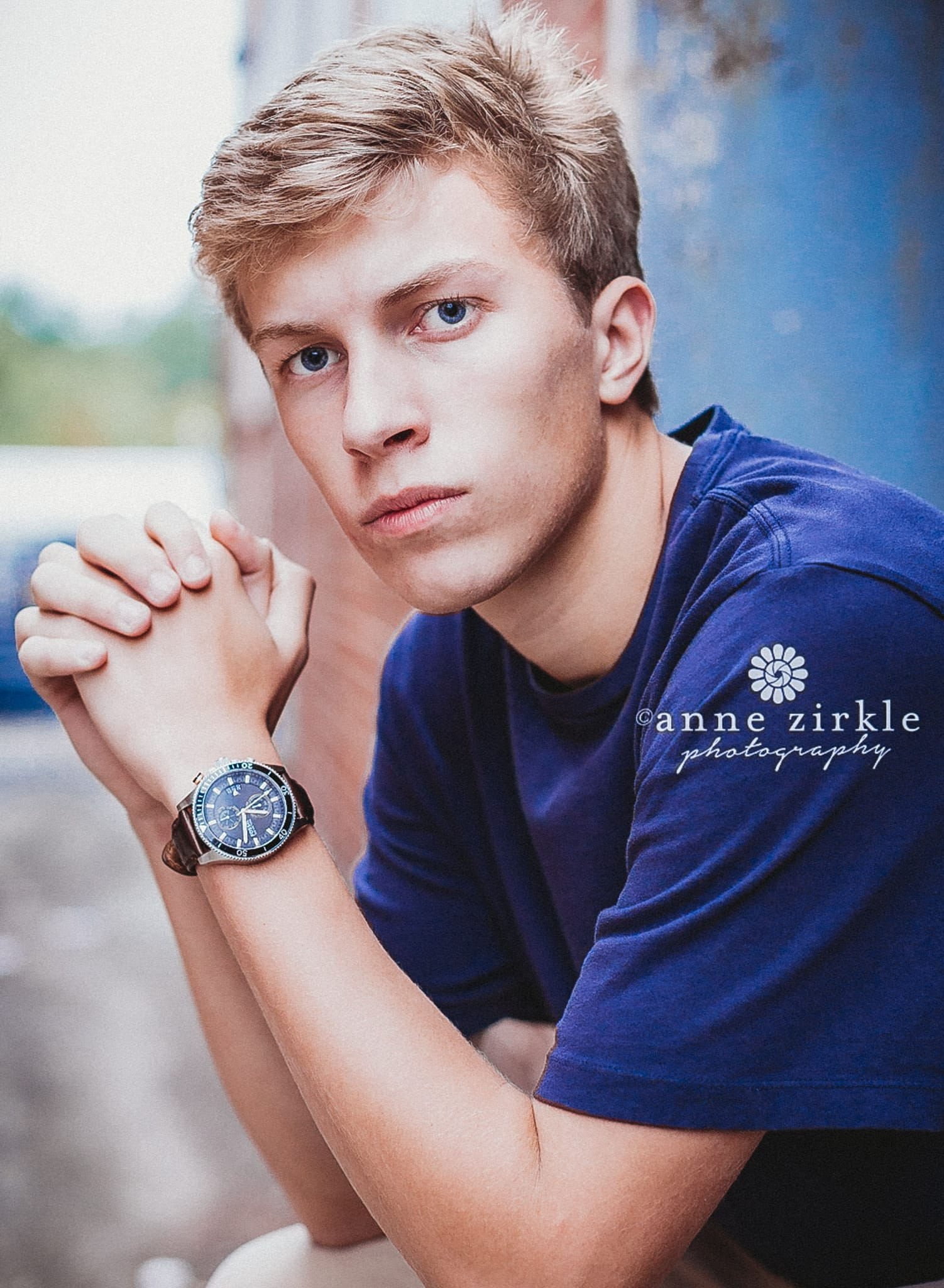 senior boy sitting by weathered door #mooresville #northcarolina #davidson #lakenorman #southiredell #pinelakeprep #highschool #highschoolsenior #highschoolseniors #seniors