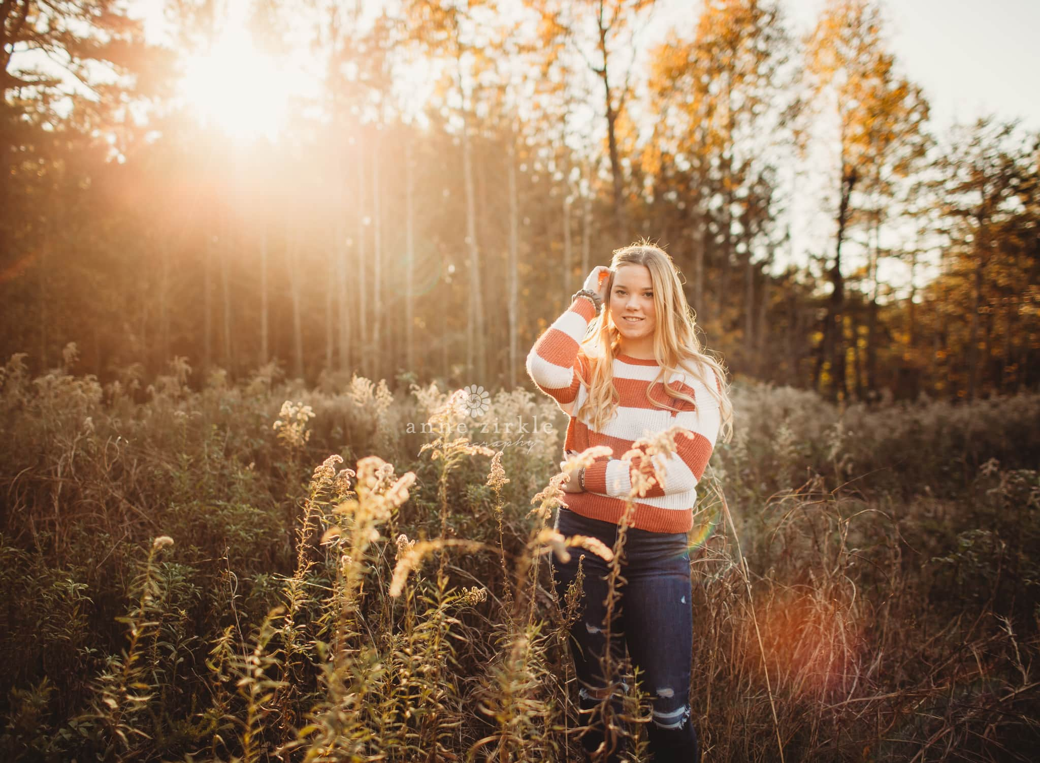 senior girl fall field sunflare