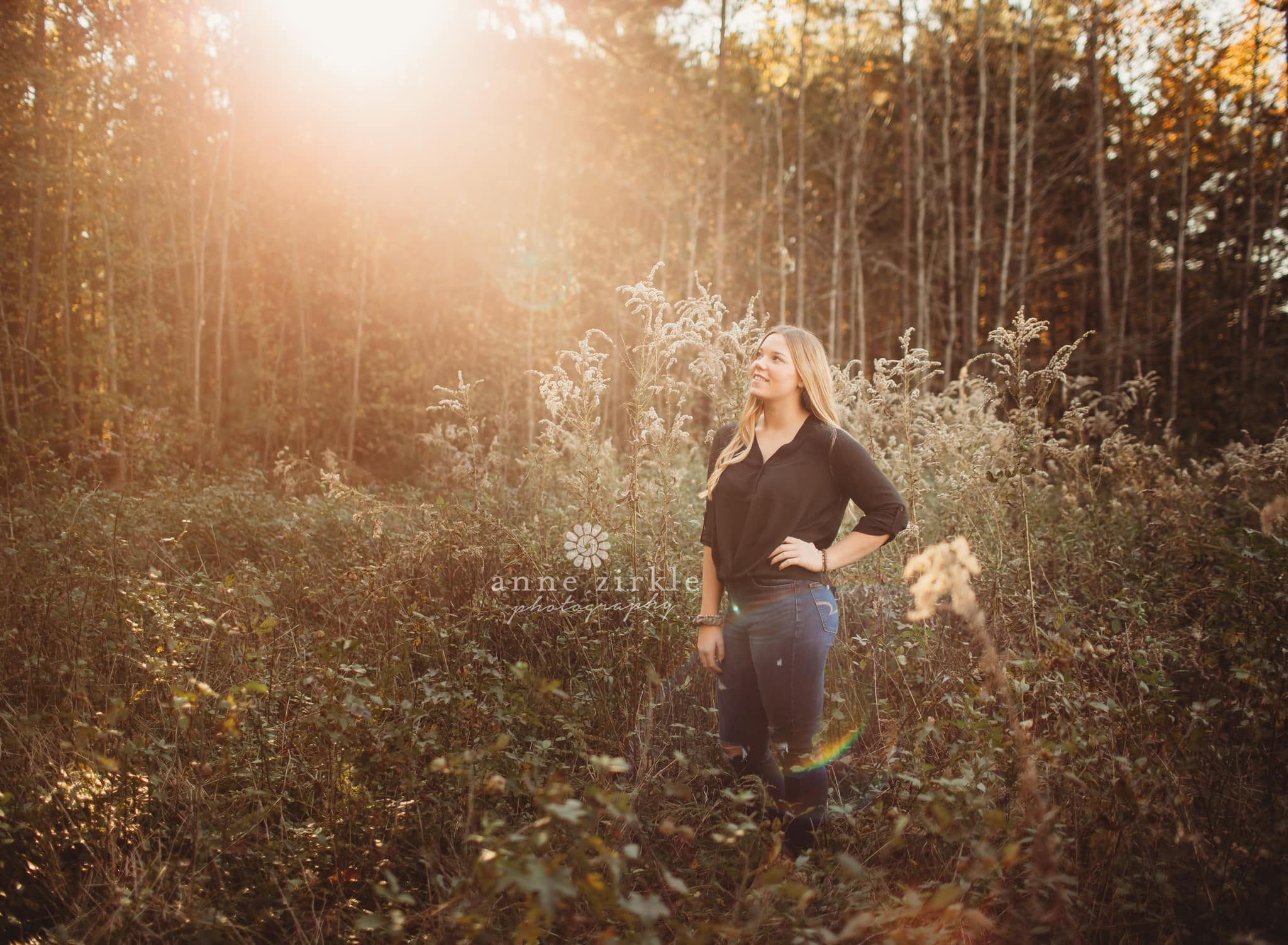 senior girl fall wildflowers golden hour