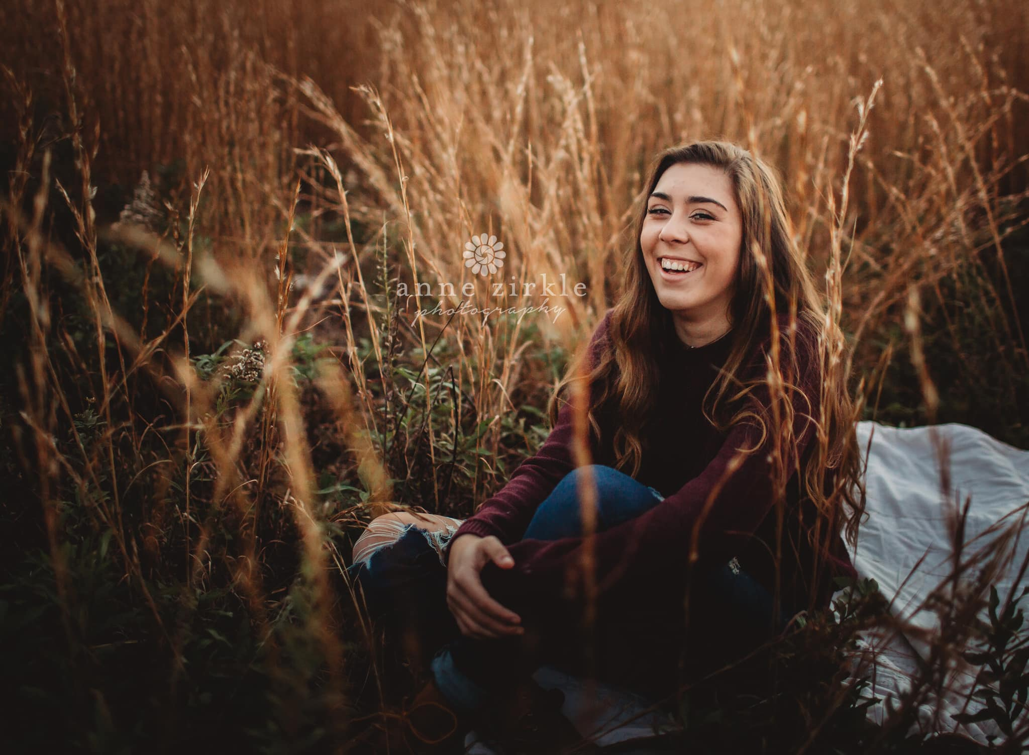 senior girl laughing in autumn field